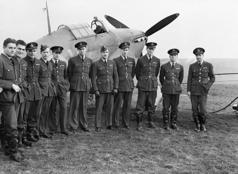 Pilots_of_No._1_Squadron_RCAF_with_one_of_their_Hawker_Hurricanes_at_Prestwick,_Scotland,_30_October_1940._CH1733
